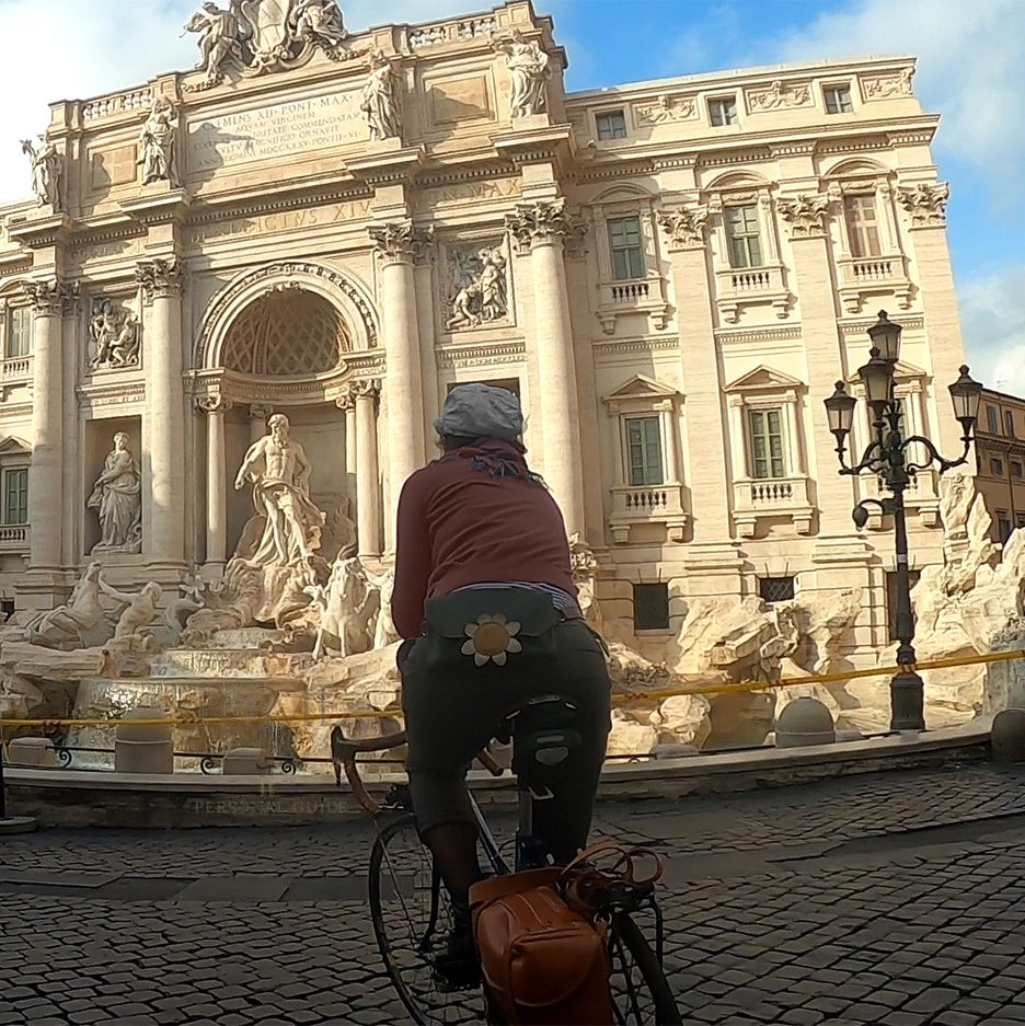 Picture of me while guiding a panoramic bike tour arriving at Trevi Fountain